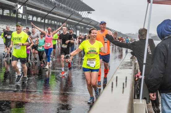 Channel 13 helps to cheer participants on while they enjoy their lap around the Indianapolis Motor Speedway despite the rain during the Annual OneAmerica 500 Festival Mini-Marathon on Saturday, May 4, 2019.