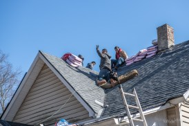 Big Boy Construction, a local business out of Beech Grove, installs a new roof on the Photographic Melodie Gallery and outdoor event space in Southport, Indiana on March 2, 2021. Photo cred Melodie Yvonne