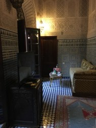 Our sitting room with divan and mosaic tile walls