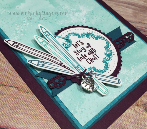 The coordinating Arts & Crafts die set cuts out markers, pencils, buttons, and even a paper clip!