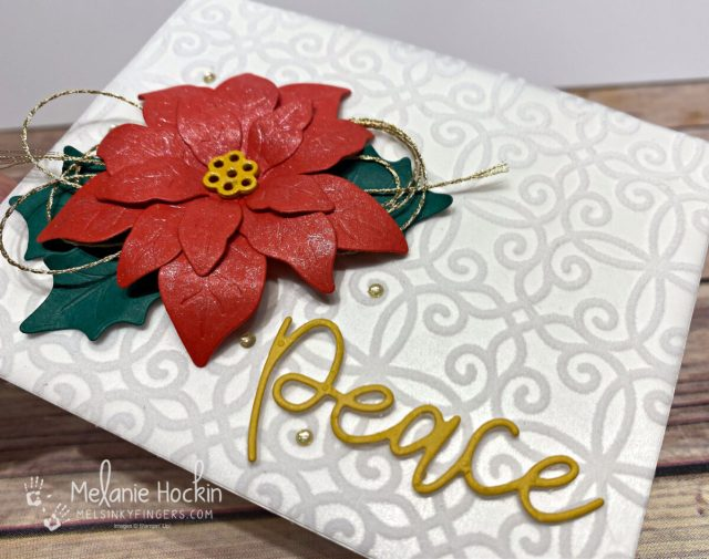 poinsettia card with plush poinsettia paper, shimmer paint, and peace die