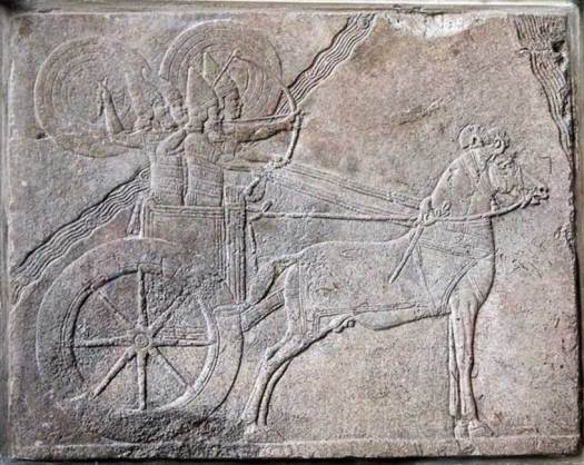 Assyrian chariot with charioteer and archer protected from enemy attack by shield bearers. Assyrian relief from Nineveh. Alabaster relief, made about 650 BC.