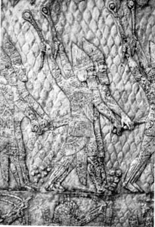 Assyrian warriors hurling stones. The carving is from a wall decoration in the palace of Sennacherib at Nineveh (early seventh century BCE).
