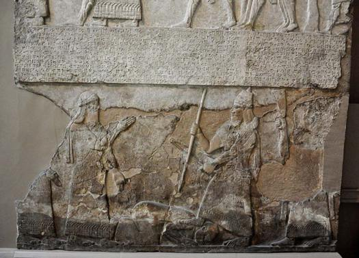 Tiglath-pileser III stands over an enemy, bas-relief from the Central Palace at Nimrud.