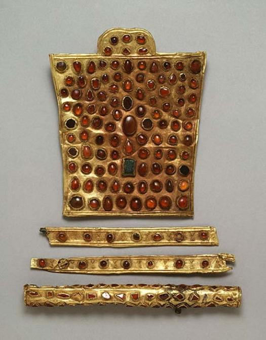 'This fine and rare set of horse trappings is decorated with stones in beaded settings- a style Hunnish metalworkers favored. Fourth century. The large piece is a chamfron, which was worn on the horse's head above the eyes. This one is ornamental rather than defensive and indicated the wealth and power of the horse's owner.'