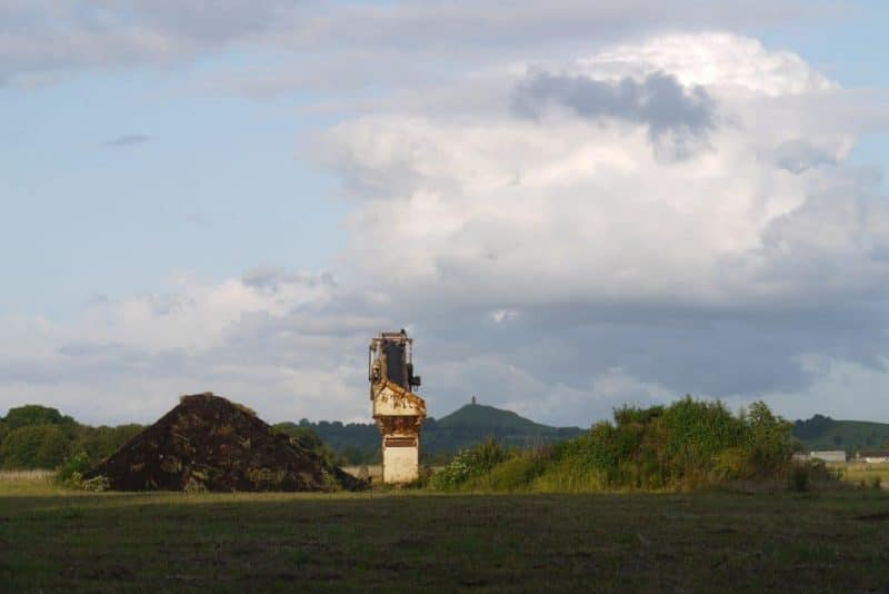 Glastonbury Tor with Industrial Peat Conveyor in Foreground
