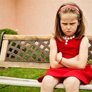 pouting child on bench