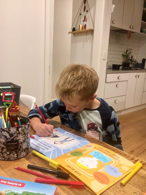 Picture of child completing baby + me book.