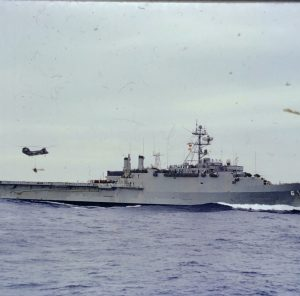 Helicopter dropping supplies on ship