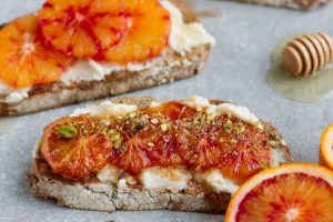 vegan blood orange breakfast toast with cream cheese, agave, pistachio and pomegranate