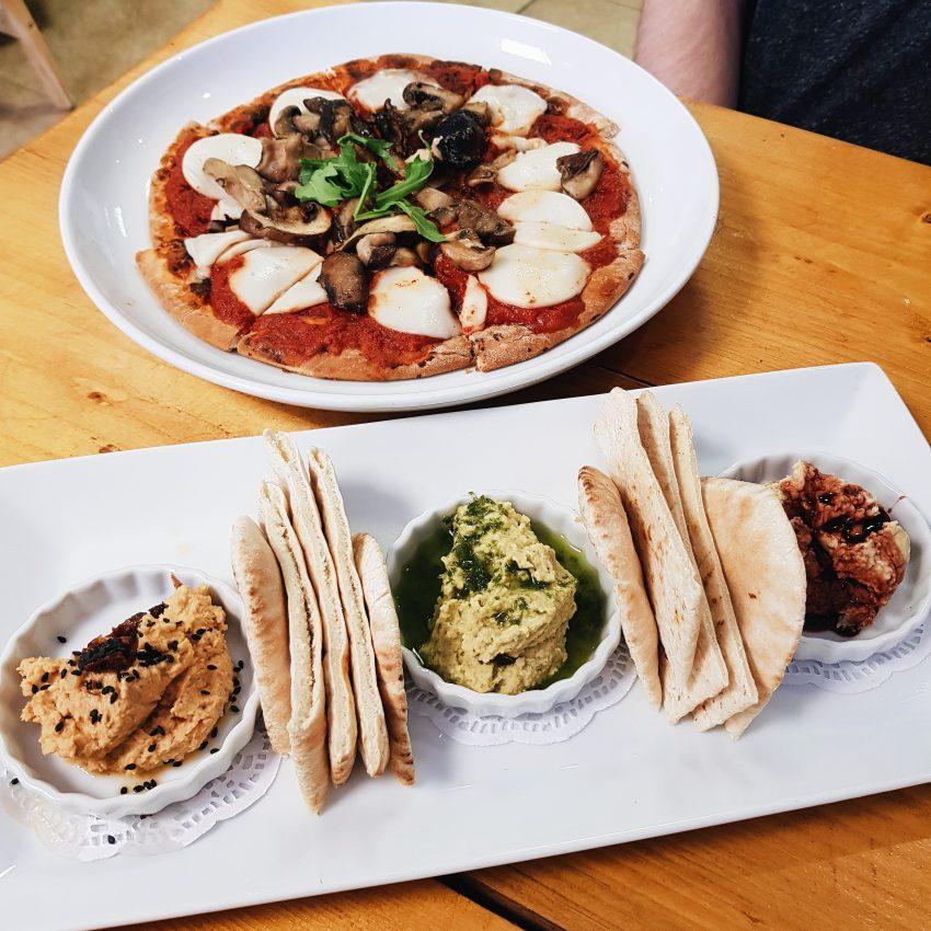 vegan pizza and hummus trio from The eating gorilla vegan cafe in Penrhyn, gwynedd, North Wales