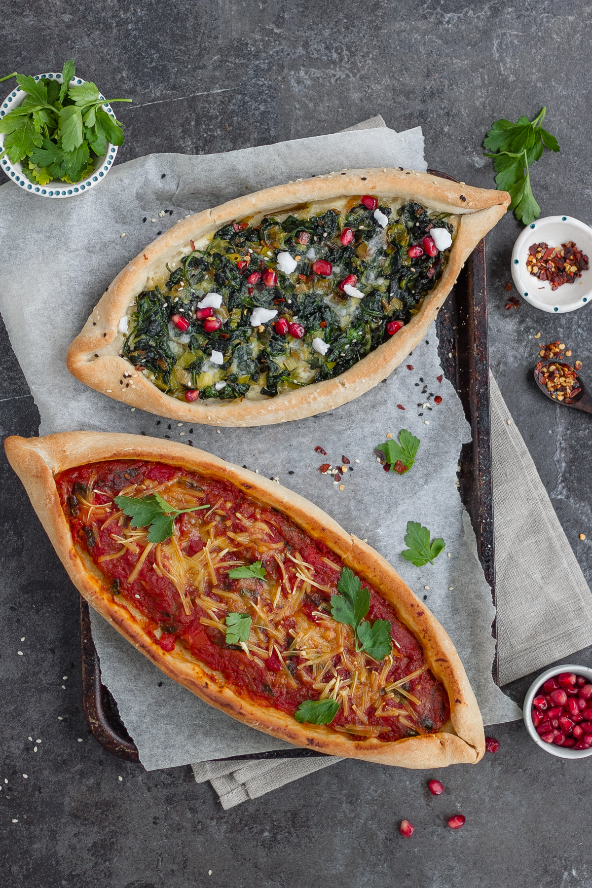 turkish vegan pide two ways; spinach,leek and vegan feta plus tomato, aubergine and red pepper toppings