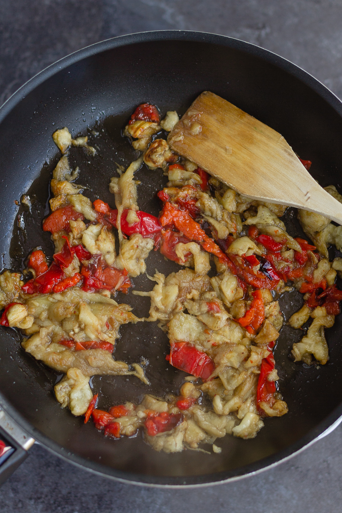 frying the roasted aubergine and red pepper