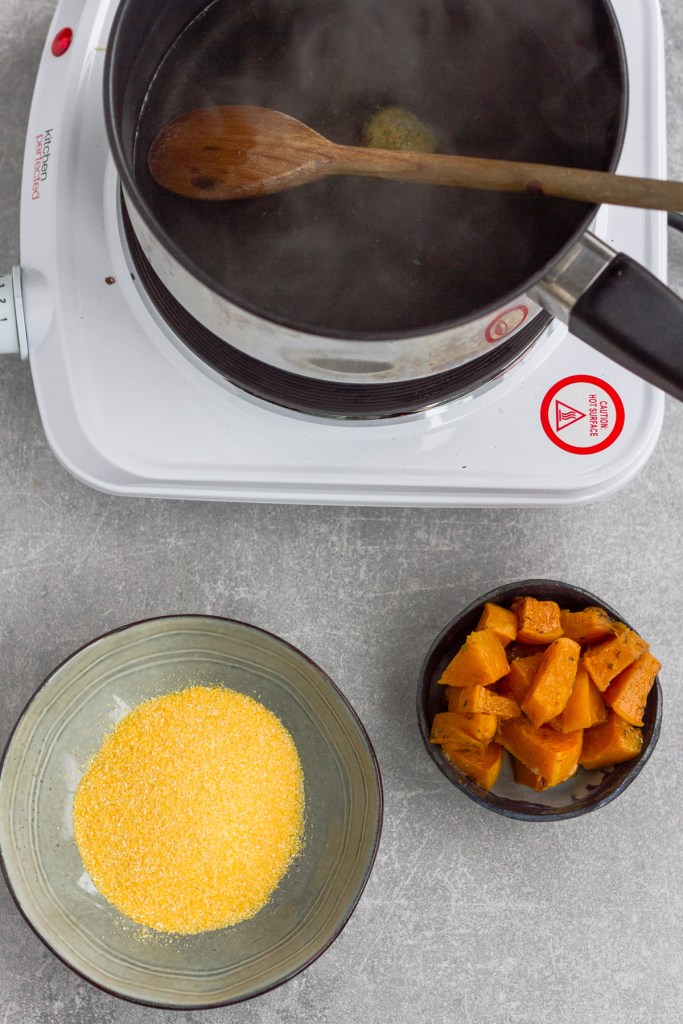 dry polenta, butternut squash and water in pan