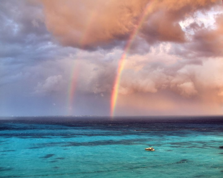 "Double rainbow during a stormy Cancun afternoon. ""Dare to love yourself as if you were a rainbow with gold at both ends,"" wrote Aberjhani in The River of Winged Dreams. Photo #4 by purolipan"