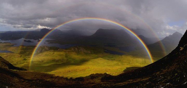 "The photographer wrote, ""Just as we reached the saddle of Stac Polaidh we were rewarded with the best rainbow(s) I have ever seen. Looking north across Loch Sionascaig to Suilven. Cul Mor and Cul Beag to the right."" Photo #13 by David Ian Roberts"