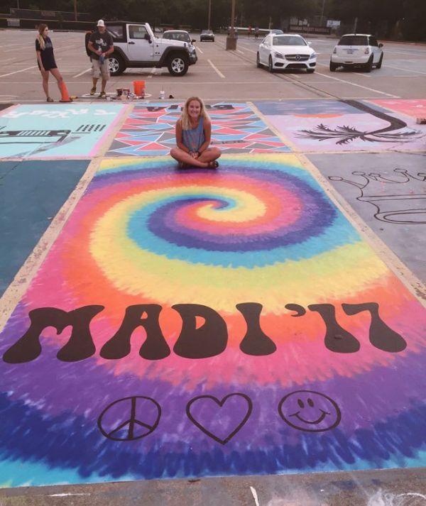 high-schools-let-their-seniors-paint-their-parking-spots-24