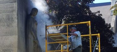 Steam cleaning Cambridge's Galt Cenotaph.