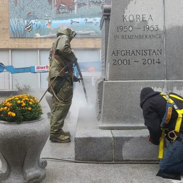 Deep cleaning the base of the Chatham Cenotaph.