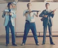 Em maio de 1.986, no Stande de tiro da ACADEPOL, os Policiais Civis: Flavio Luis Marques,com a metralhadora INA; com a calibre 12, João Caçula Kasemiro , e Ivan com a carabina Puma.