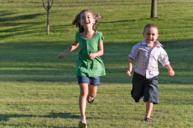 two-happy-little-kids-having-fun-while-running-through-the-grassy-field-and-racing-against-each-other_rFue50_CBj.jpg