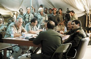 The photo above was taken on March 3, 1991, at Safwan, Iraq. Visible in the image are Gen. H. Norman Schwarzkopf, the commander in chief of US Central Command, along with Saudi Lt. Gen. Khalid Bin Sultan, commander of the Joint ArabIslamic Force, sitting next to him. Accross the table, facing them, are officers from the Iraqi delegation. (photo courtesy of globalsecuirty.org