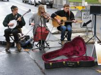Busking in the hope of receiving small change from passers by