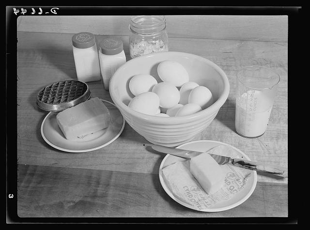Share The Meat recipes. Baked eggs with cheese. Rich in iron and vitamin B, eggs can be cooked a hundred delicious ways. Baked eggs with cheese is a particularly good egg dish, simple and quick to prepare. Ingredients, in addition to eggs, are grated cheese, bread crumbs, milk, butter, salt and pepper.  October 1942
