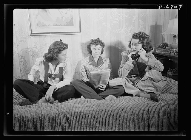 Health measures for low home temperatures. Planning to spend a winter evening at home? Better dress for it the way these attractive government workers do, for homes will be kept to sixty-five degrees this year because of the Federal fuel oil limitation orders. Slacks and warm robes mean comfort under lower temperatures.  1942 October.  Albert Freeman, photographer (Library of Congress)