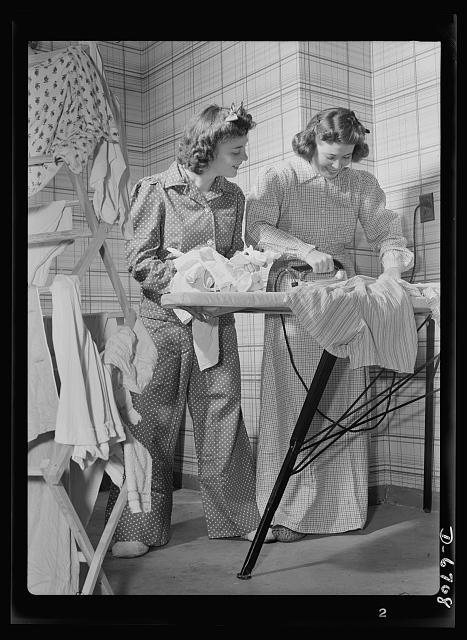 Health measures for low home temperatures. Down goes the thermometer and out comes flannel nightclothes, almost like the kind grandpa used to wear, as government workers in Washington D.C. dress for the sixty-five degree maximum temperature recommended by the fuel oil limitation order.  1942 October.  Albert Freeman, photographer (Library of Congress)