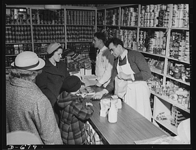 Mrs. Catherine Herbster budgets herself carefully. She buys those vegetables and food which are plentiful and cheap. She must see that her family of growing children get the right foods to make them strong and healthy.  Possibly 1941.  (Photo: US Office for Emergency Management)