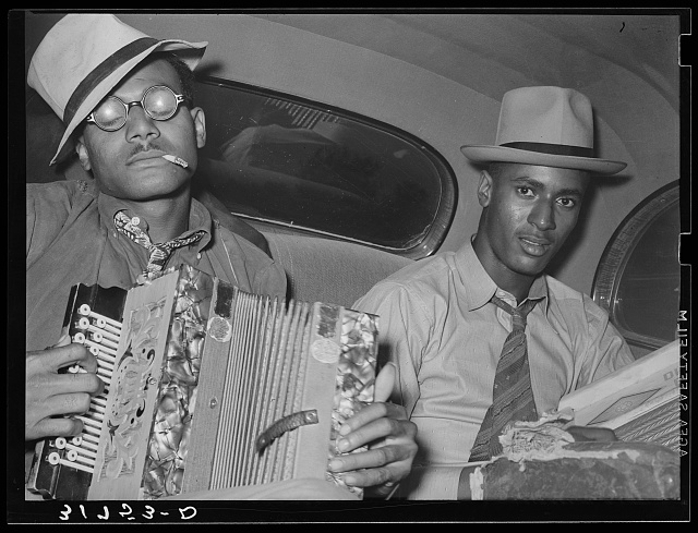 Negro musicians playing accordion and washboard in automobile. Near New Iberia, Louisiana.  1938 Oct.  Russell Lee, photographer (Library of Congress)
