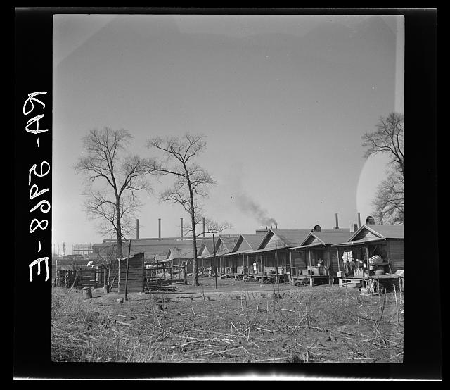 Slum housing conditions on the outskirts of a steel mill. Ensley, Alabama.  February 1937