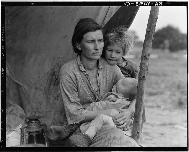 Migrant agricultural workers family. Seven hungry children. Mother aged thirty-two. Father is a native Californian. Destitute in pea pickers camp, Nipomo, California, because of the failure of the early pea crop. These people had just sold their tent in order to buy food. Of the twenty-five hundred people in this camp most of them were destitute.  February or March 1936.  (Photo: Dorothea Lange)
