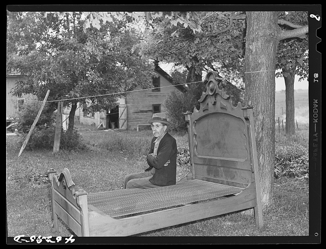 Mr. M.B. Kiechle watching his grandson moving out of the area being taken over by Pine Camp expansion. Mr. Kiechles own farm is just outside the boundary line of the area.  August 1941