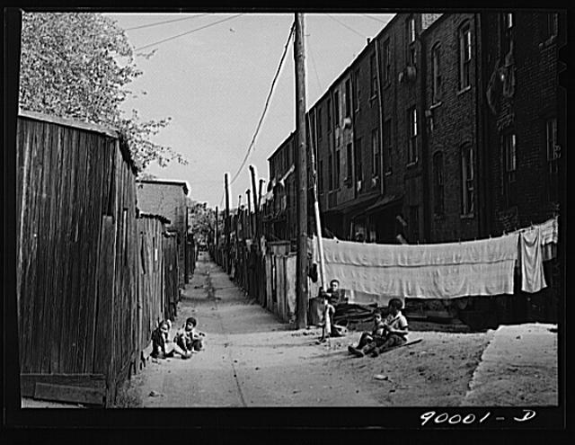 Children playing in De Frees Alley, N.E. near the Capitol building. One basement room rents for nine dollars a month; two rooms upstairs for sixteen dollars; one bath and cold water in the hall for entire building.  September 1941