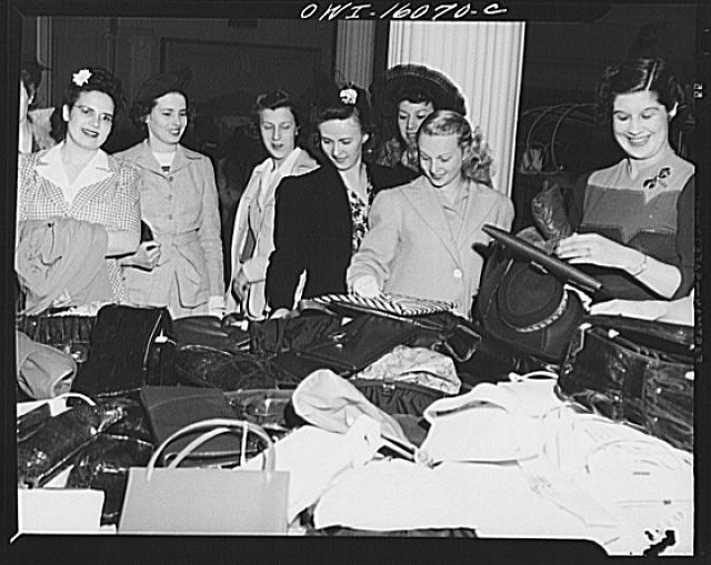 Detroit, Michigan. Chrysler girls shopping for pocketbooks following a style show presented by the Chrysler Girls Club of the Chrysler Corporation at Saks Fifth Avenue store.  Fall 1942