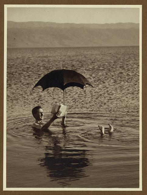 Floating in the Dead Sea.  (From a negative taken approximately 1900 to 1920)