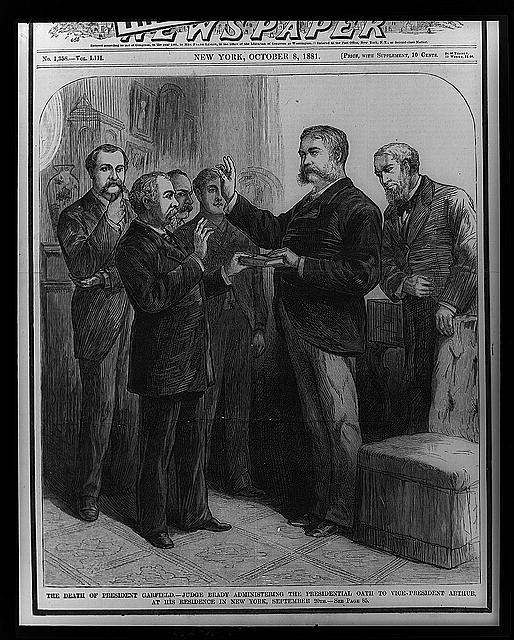 Justice John R. Brady, Justice of New York State Supreme Court, administering the oath of office to Vice President Arthur, 21st President of the United States (1881 - 1885), in a private ceremony in Chester Arthurs residence at 123 Lexington Avenue, New York.  (1881)