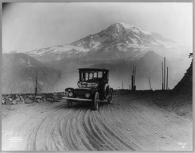 Detroit Electric auto on promotional tour through mountains from Seattle to Mt. Rainier: Mt. Ranier in background, c. 1919.