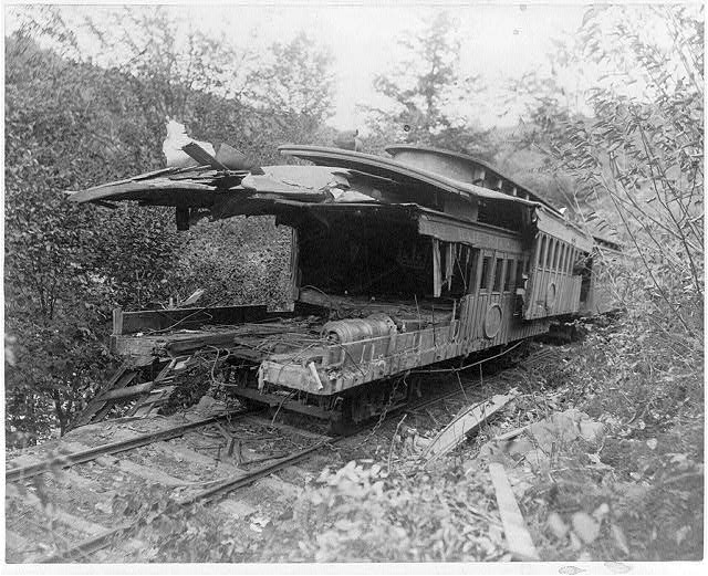 Telescoped cars of Mud Run disaster, October 10, 1888; 2 railroad cars rammed together lengthwise.  (Photo copyrighted by C.F. Cook)