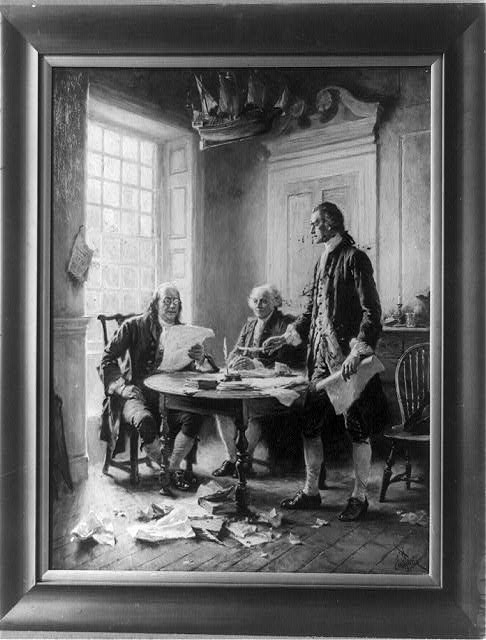 Benjamin Franklin reading draft of Declaration of Independence, John Adams seated, and Thomas Jefferson standing and holding feather pen and paper, around table.  Jean Leon Gerome Ferris, artist.  Published c.1921 (Library of Congress)