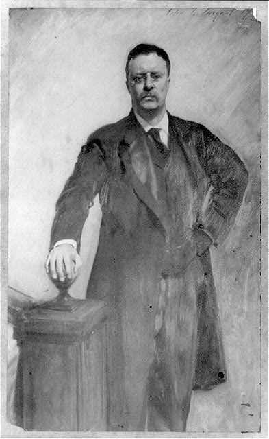 Theodore Roosevelt, three-quarter length portrait, standing, facing front, right hand on stairway post.  Reproduction of painting by John Singer Sargent.  c.1903 (Library of Congress)
