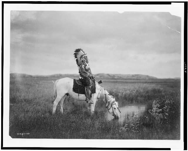 Red-Hawk was photographed numerous times by several renowned western photographers. This photo was taken by Edward S. Curtis, circa 1913.