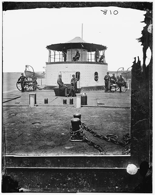 [Charleston Harbor, S.C. Deck and officers of U.S.S. monitor Catskill; Lt. Comdr. Edward Barrett seated on the turret].