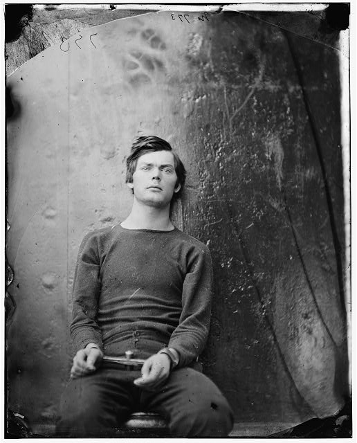 Washington Navy Yard, D.C. Lewis Payne (Powell), in sweater, seated and manacled.
