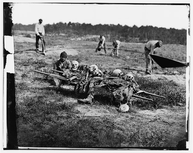 Cold Harbor, Va. African Americans collecting bones of soldiers killed in the battle.  Photograph from the main eastern theater of war, Grants Wilderness Campaign, May-June 1864.  Published April 1865.  John Reekie, photographer (Library of Congress)