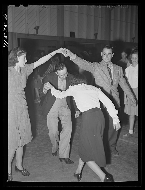 Woodville, California. FSA (Farm Security Administration) farm workers' community. Square dance at the Saturday night dance.