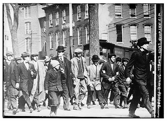 William Dudley (Big Bill) Haywood, an American labor movement leader, marching with strikers in Lowell, Massachusetts.  Circa 1912.