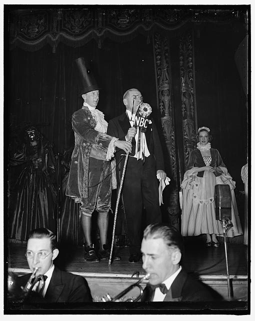 Vase disguise awarded prize at colorful ball in Capitol. Washington D.C. A prize well deserved was awarded to A. Richard Hill who attended Washingtons colorful Bal Boheme Ball last night representing a Louis XIV vase. Receiving honorable mention for the most original costume Hill is shown being introduced by Rep. Sol Bloom of New York.  1937 February 2.  (Library of Congress)